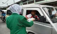 Pembagian Masker & Leaflet PMB di beberapa Lampu Merah di Kota dan Kabupaten Jayapura